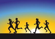 Kontur av löpare på soluppgång Arkivfoto
