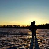 kontur backlit solnedgång Fotografering för Bildbyråer
