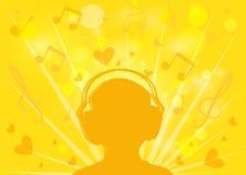 Kontur istota ludzka z hełmofonami na żółtym tła bokeh Obrazy Royalty Free