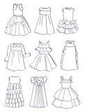 Konturer av festliga klänningar för små flickor Arkivfoton
