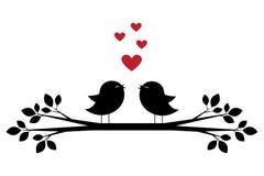 Konturer av gulliga fåglar sjunger och röda hjärtor Arkivfoto