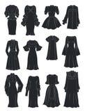 Konturer av klänningar med frodiga muffar och krås Arkivfoton