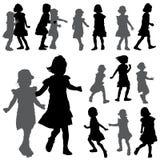 Konturer av små flickor på den vita bakgrunden Royaltyfria Bilder