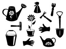 Konturer av trädgårds- hjälpmedel. Arkivfoto