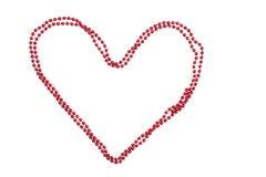 Konturowy serce czerwoni koraliki na białym tle Fotografia Royalty Free
