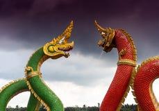 Konung av Nagas i röd och grön färg Arkivfoton