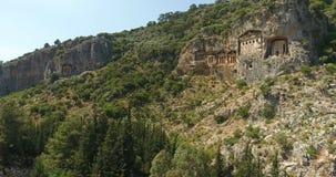 Konung Tombs av Lycians längd i fot räknat för Dalyan Turkiet antenn arkivfilmer