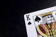 konungpokerkort på svart bakgrund Royaltyfri Foto