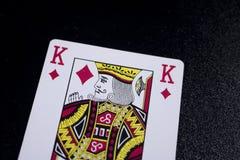 konungpokerkort på svart bakgrund Arkivfoto