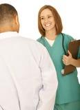 konversation som har den medicinska personalen Arkivbild