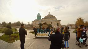 Large letters of KONYA, Selimiye Mosque, Mevlana Museum on the background. KONYA / TURKEY - 11.20.2016 central streets of the ancient Turkish city stock video