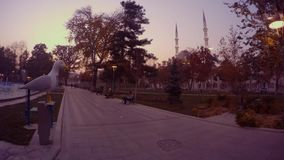 Panorama to the evening park in the center of the Turkish city of Konya. KONYA / TURKEY - 11.20.2016 central streets of the ancient Turkish city stock video footage