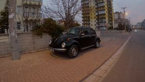Retro car on streets of the ancient but modern Sufi Turkish city. KONYA / TURKEY - 11.20.2016 central streets of the ancient Turkish city stock video