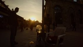 Silhouette of leech seller near mosque in downtown Konya. KONYA / TURKEY - 11.20.2016 central streets of the ancient Turkish city stock footage