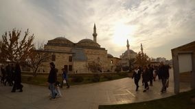 Tourists and pilgrims at sunset near Selimiye Mosque, Mevlana Museum in Konya. KONYA / TURKEY - 11.20.2016 central streets of the ancient Turkish city stock footage