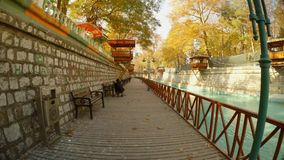 Wooden platform and a bench next to a canal in the ancient city of Konya. KONYA / TURKEY - 11.20.2016 central streets of the ancient Turkish city stock video