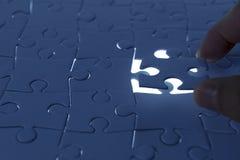 Konzentrieren Sie sich auf das unterere Kapitel des Puzzlespiels Lizenzfreie Stockfotografie