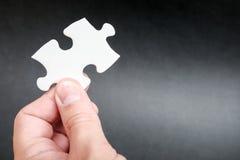 Konzentrieren Sie sich auf das unterere Kapitel des Puzzlespiels Stockfotografie