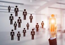 Konzept der Führung und des Teamworkings mit vielen Ikonen und eine von ihnen heraus stehend Lizenzfreie Stockfotos