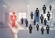 Konzept der Führung und des Teamworkings mit vielen Ikonen und einem von Lizenzfreie Stockfotografie