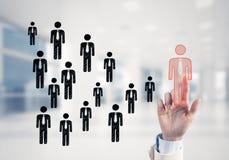 Konzept der Führung und des Teamworkings mit vielen Ikonen und einem von Stockfotografie