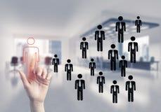 Konzept der Führung und des Teamworkings mit vielen Ikonen und einem von Lizenzfreie Stockbilder