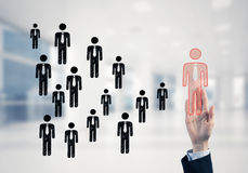 Konzept der Führung und des Teamworkings mit vielen Ikonen und einem von Stockfoto