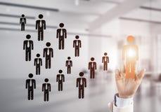 Konzept der Führung und des Teamworkings mit vielen Ikonen und einem von Lizenzfreies Stockbild