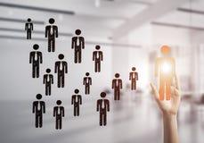Konzept der Führung und des Teamworkings mit vielen Ikonen und einem von Stockbild