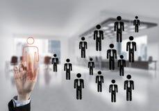 Konzept der Führung und des Teamworkings mit vielen Ikonen und einem von Lizenzfreie Stockfotos