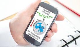 Konzept der globalen Erwärmung auf einem Smartphone Stockfotos