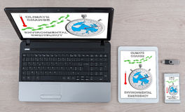 Konzept der globalen Erwärmung auf verschiedenen Geräten Lizenzfreies Stockbild