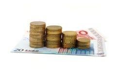 Konzept der Rezession mit Banknoten und Münzen Lizenzfreies Stockfoto
