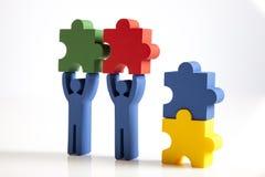 Konzept der Teamwork, der Leute und der Ikonen Lizenzfreie Stockbilder