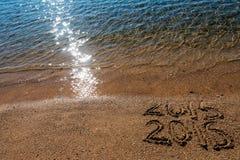Konzept 2016 des neuen Jahres auf dem Sand Stockfoto