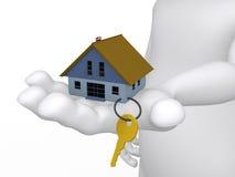 Konzept einer Hand, die ein Haus und eine Taste anhält Lizenzfreies Stockbild
