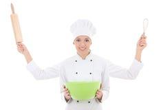 Konzept kochen - Frau in der Chefuniform mit vier Handdem halten Stockfotos