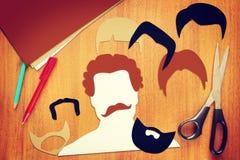 Konzept von verschiedenen männlichen Haarschnitten Stockbilder