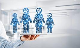 Konzept von Zusammenarbeit oder möglicherweise Familie mit zwei Zahlen, die Paare und Beziehungen darstellen Lizenzfreies Stockbild