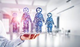 Konzept von Zusammenarbeit oder möglicherweise Familie mit zwei Zahlen, die Paare und Beziehungen darstellen Lizenzfreie Stockfotos