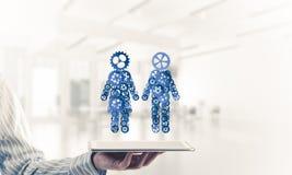 Konzept von Zusammenarbeit oder möglicherweise Familie mit zwei Zahlen presenti Stockfotografie
