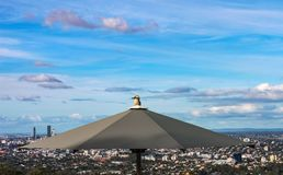 A kookaburra bird perched on top of an umbrella at the lookout on Mt Coot-tha overlooking Brisbane in Queensland Australia.  stock photography