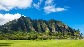 Koolau mountain range in Hawaii. With blue sky and white clouds Royalty Free Stock Photography