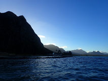 Koolau Mountains with last light of day streaming towards water Royalty Free Stock Photography