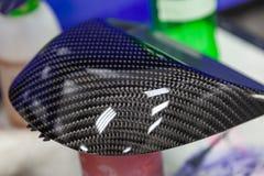 Koolstofelement van auto grijs en zwart in de vorm van het weven van Kevlar, een zeer duurzaam en lichtgewicht modern materiaal v stock afbeeldingen