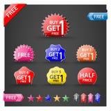 Koop één krijgen één vrije, promotieverkoopetiketten geplaatst. Stock Fotografie