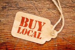 Koop lokaal teken op een prijskaartje stock foto's