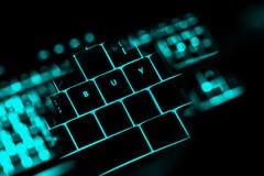 Koop tekst op de verlichte knopen van het toetsenbord royalty-vrije stock afbeelding