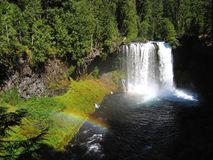 Koosah Falls with rainbow, McKenzie River, Oregon Royalty Free Stock Images