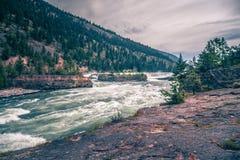 Kootenai river water falls in montana mountains. Kootenai river water falls in  montana mountains Royalty Free Stock Images